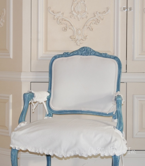 Slip covered bergere chair with a blue finish