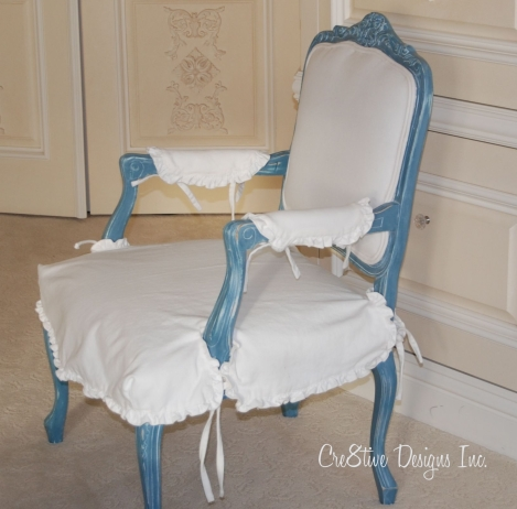 Bergere chairs slip covered in white fabric