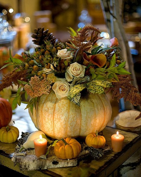 Pumpkin filled with flowers as a centerpiece