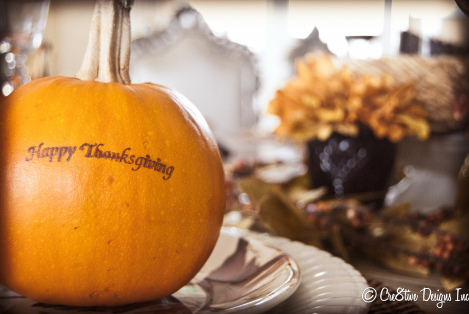Happy Thanksgiving stamped on a pumpkin