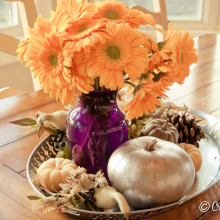 Thanksgiving centerpiece with beeswax pumpkin candles