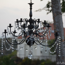 Transformation of a brass chandelier with acrylic crystals
