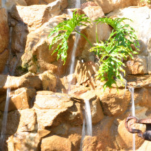 Master bathroom a natural rock waterfall