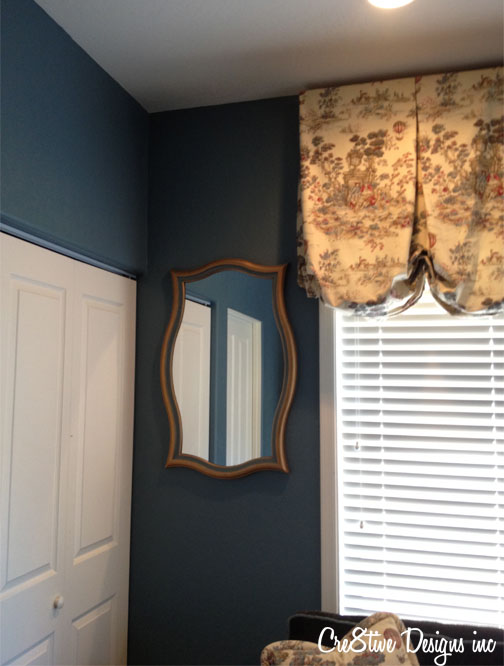 HomeGoods painted gold mirror