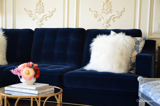 Blue velvet tufted sofa