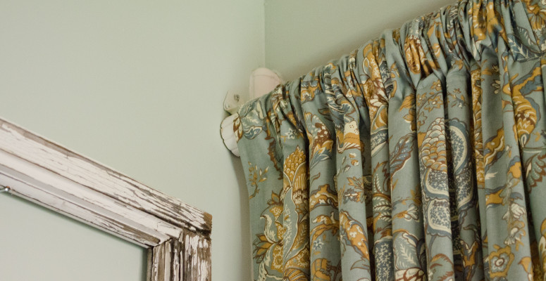 Using ready-made drapes for a shower curtain