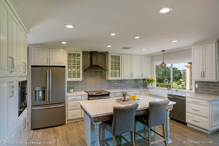 Ivory shaker cabinets and gray backsplash