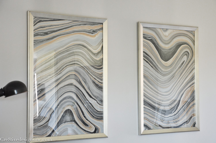 Marble artwork in silver frames