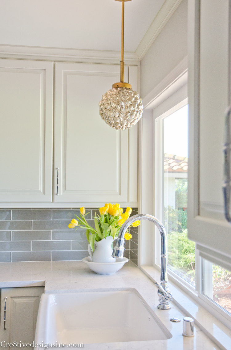 Pendant light over farmhouse sink