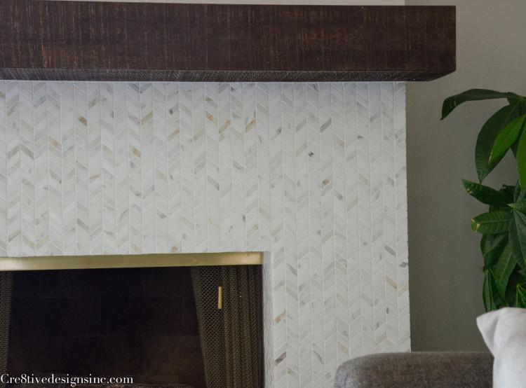 calcutta marble chevron fireplace surround