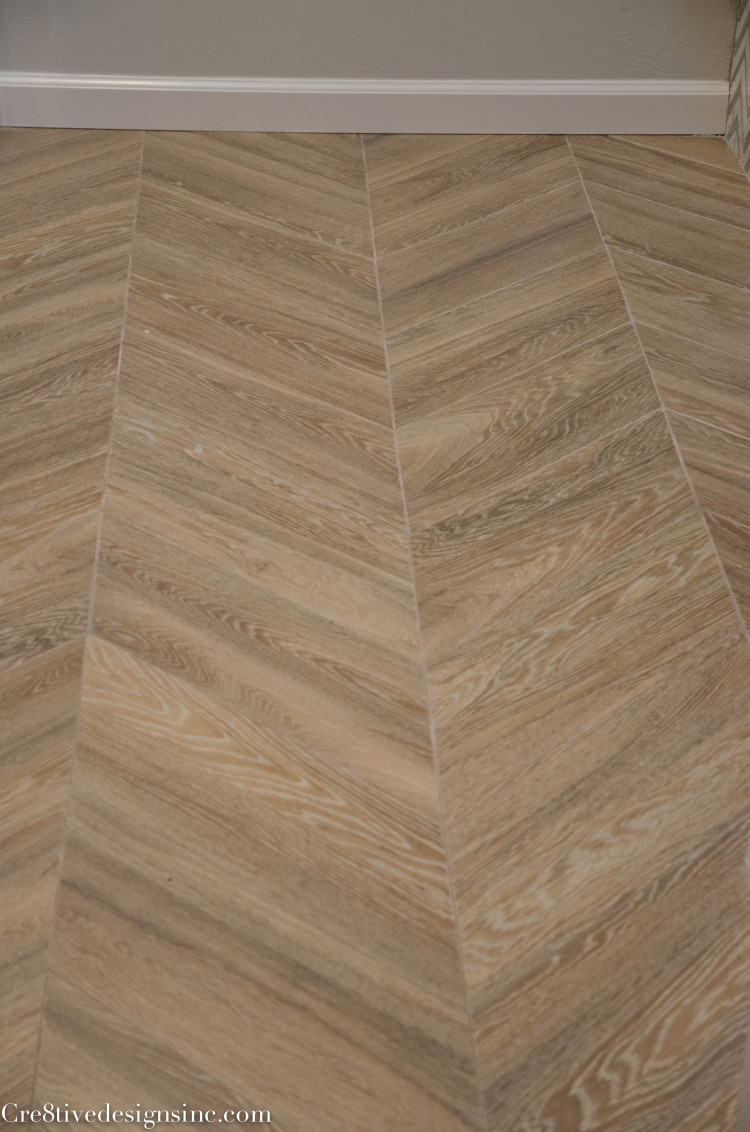 wood look porcelain tiles laid in a chevron pattern