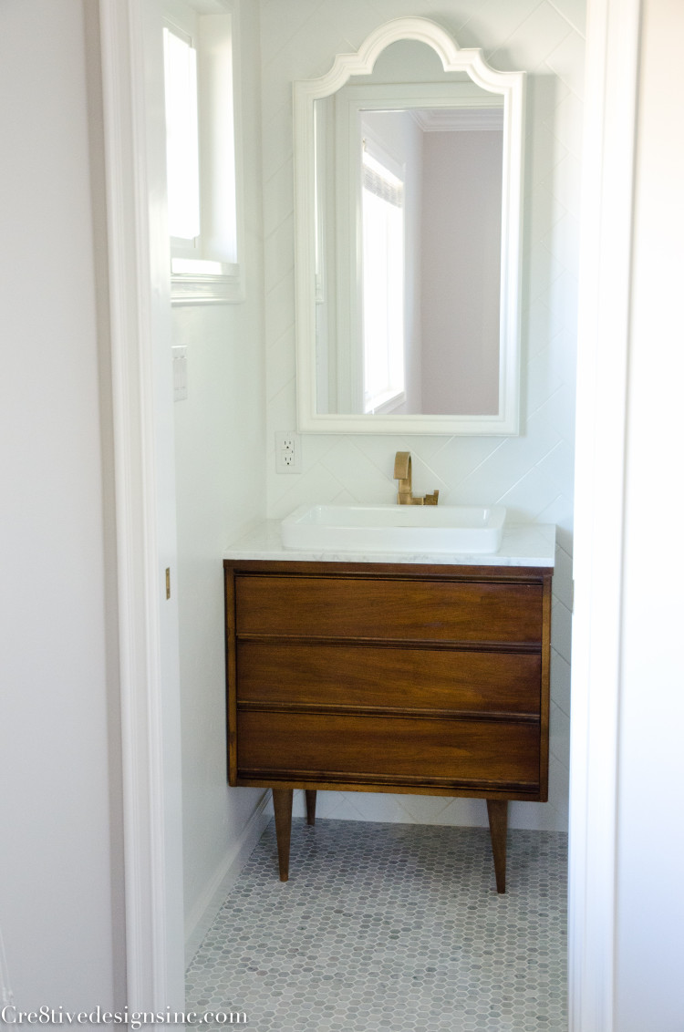 Designing a tiny bathroom cre8tive designs inc Bathroom sink cabinets modern
