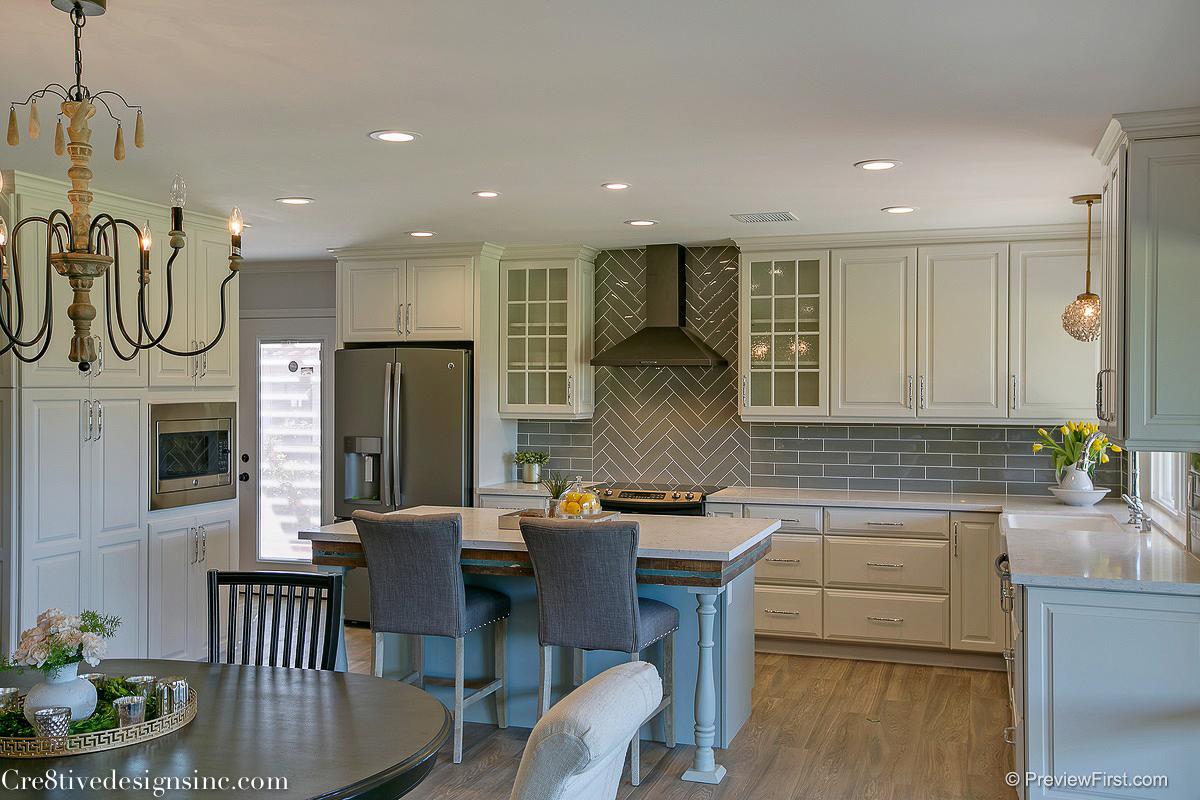 New Ivory shaker cabinets and gray backsplash