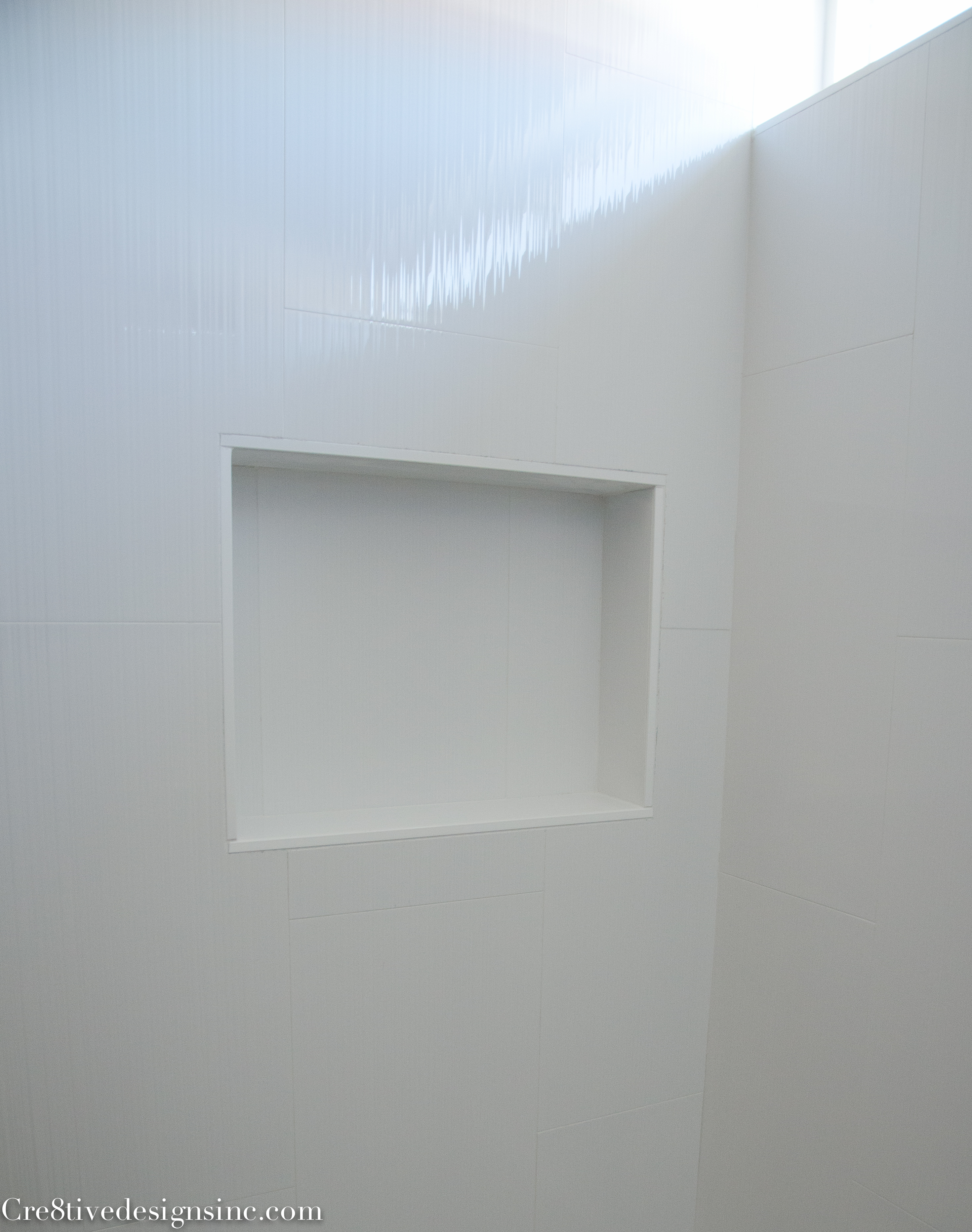 Ideal large white tiles in a tub shower area